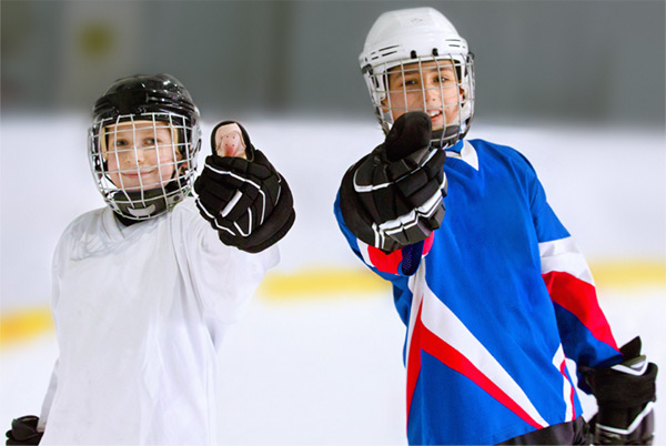 Two Kids in Hockey Gear